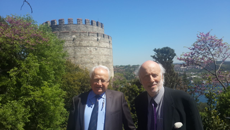 Prof. Üstün Ergüder (on the left) and Mr. Costa Carras (on the right), co-coordinators of the GTF, in front of the Rumeli Hisarı, following the GTF meeting at Boğaziçi University.